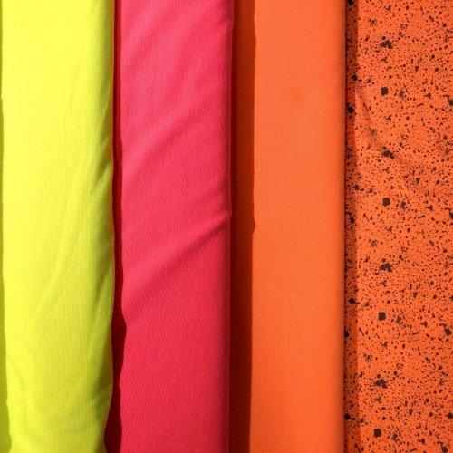 Metráž jersey úplet oboulíc neonové oranžová elastická látka na trika oblečení